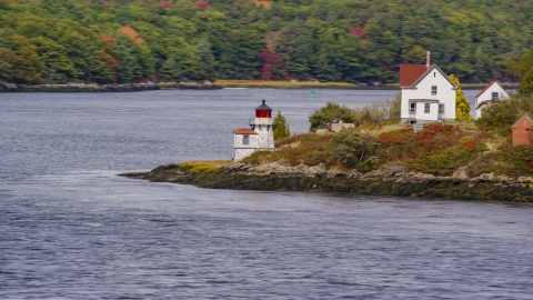 AX147_402.0000184 - Aerial stock photo of Squirrel Point Light beside the water in Arrowsic, Maine