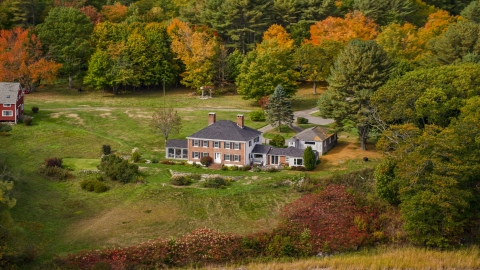 AX147_407.0000187 - Aerial stock photo of An isolated home, colorful autumn trees, Phippsburg, Maine