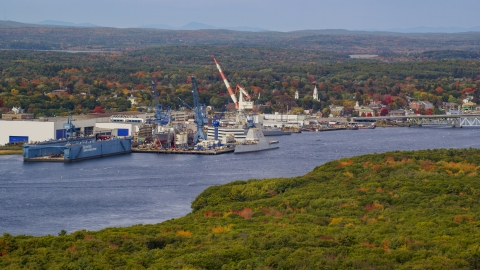 AX147_410.0000000 - Aerial stock photo of The General Dynamics Bath Iron Works factory, autumn, Bath, Maine