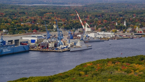 AX147_410.0000368 - Aerial stock photo of The General Dynamics Bath Iron Works in autumn, Bath, Maine