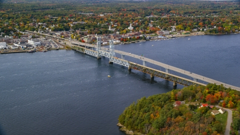 AX147_413.0000000 - Aerial stock photo of The Sagadohoc Bridge by small town, autumn, Bath, Maine