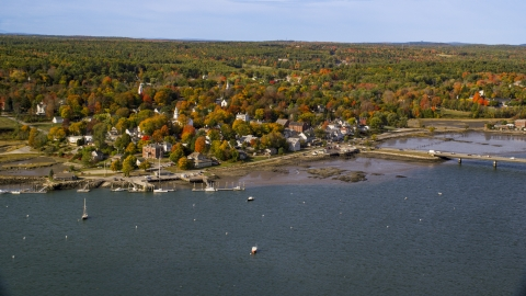 AX148_005.0000000 - Aerial stock photo of A small waterfront town in autumn, Wiscasset, Maine