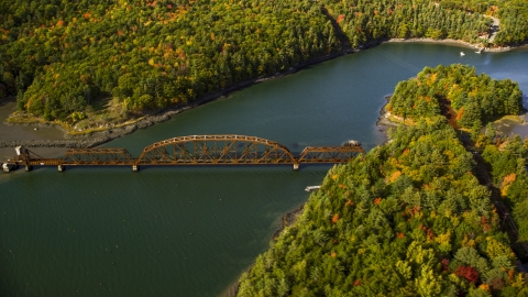AX148_006.0000195 - Aerial stock photo of A bridge spanning Sheepscot River in autumn, Newcastle, Maine