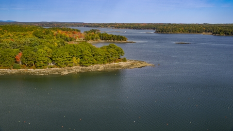 AX148_029.0000234 - Aerial stock photo of Forested islands, The Narrows in autumn, Waldoboro, Maine