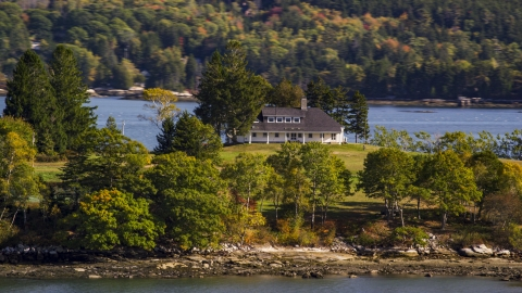 AX148_030.0000000 - Aerial stock photo of An isolated rural home in autumn, Waldoboro, Maine
