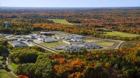 AX148_064.0000000 - Aerial stock photo of Maine State Prison by colorful forest, autumn, Warren, Maine