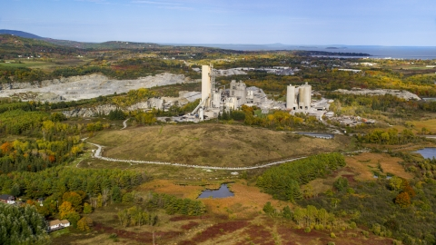 AX148_073.0000000 - Aerial stock photo of A quarry and factory in autumn, Thomaston, Maine