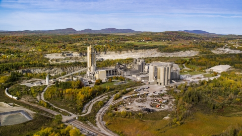 AX148_074.0000000 - Aerial stock photo of A factory near a quarry in autumn, Thomaston, Maine