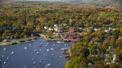 AX148_101.0000000 - Aerial stock photo of A small coastal town beside a harbor in autumn, Rockport, Maine