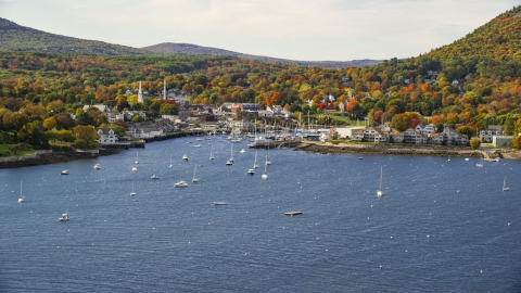 AX148_110.0000267 - Aerial stock photo of Camden Harbor and the small coastal town in autumn, Camden, Maine