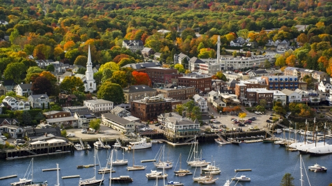AX148_112.0000022 - Aerial stock photo of A small coastal town by the harbor, autumn, Camden, Maine
