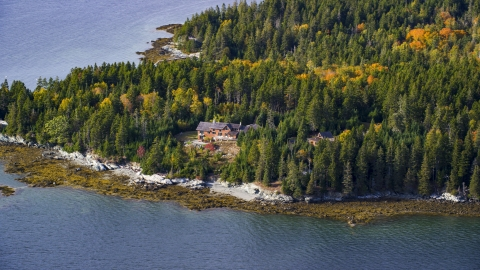 AX148_136.0000238 - Aerial stock photo of A waterfront home on an island in autumn, Little Deer Isle, Maine