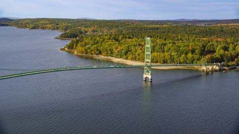 AX148_140.0000173 - Aerial stock photo of The Deer Isle Bridge in autumn, Little Deer Isle, Maine