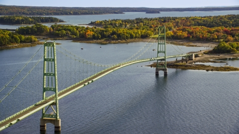 AX148_143.0000045 - Aerial stock photo of A view of the Deer Isle Bridge, colorful foliage, autumn, Maine