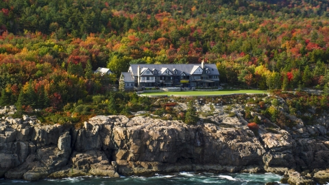 AX148_172.0000195 - Aerial stock photo of An isolated waterfront mansion, autumn, Seal Harbor, Mount Desert Island,  Maine