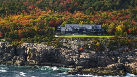 AX148_172.0000351 - Aerial stock photo of Isolated waterfront mansion and autumn trees, Seal Harbor, Mount Desert Island,  Maine
