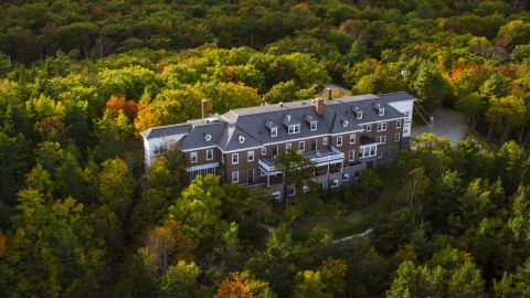 AX148_187.0000000 - Aerial stock photo of An isolated mansion, trees with autumn leaves, Bar Harbor, Maine