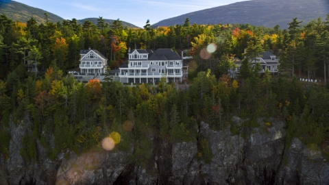 AX148_191.0000264 - Aerial stock photo of Clifftop homes overlooking the water in autumn, Bar Harbor, Maine