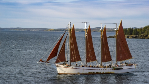 AX148_196.0000086 - Aerial stock photo of A sailing ship in Bar Harbor, Maine