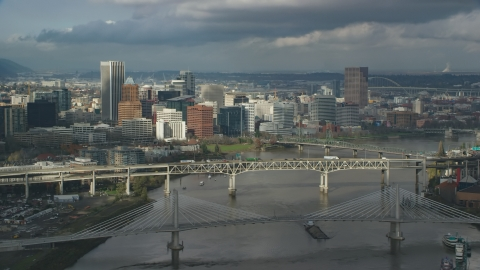 AX153_051.0000161F - Aerial stock photo of Bridge over the Willamette River and the city skyline, autumn, Downtown Portland, Oregon
