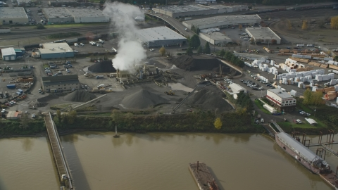 AX153_062.0000190F - Aerial stock photo of A manufacturing plant and rising steam, Northwest Portland, Oregon