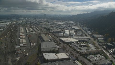 AX153_063.0000297F - Aerial stock photo of Warehouses and train yard in an industrial area, Northwest Portland, Oregon