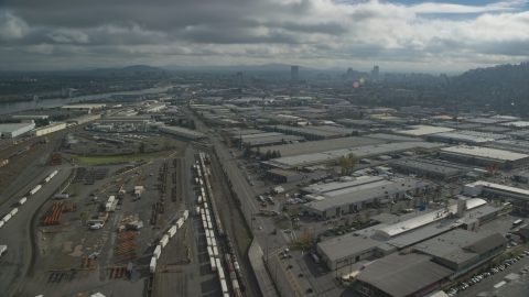 AX153_064.0000359F - Aerial stock photo of A train yard and warehouses in Northwest Portland, Oregon