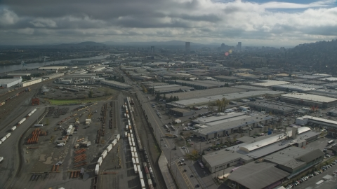 AX153_065.0000000F - Aerial stock photo of A train yard and warehouse buildings in Northwest Portland, Oregon