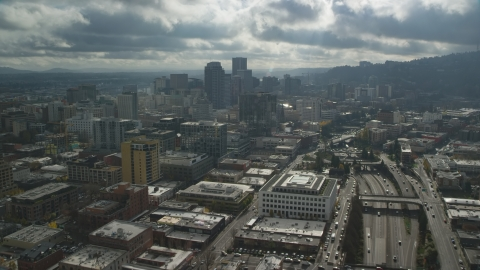 AX153_069.0000199F - Aerial stock photo of Downtown Portland and Interstate 405 in Oregon