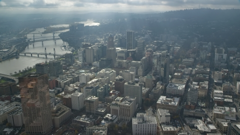 AX153_078.0000152F - Aerial stock photo of Godrays over the Willamette River and skyscrapers in Downtown Portland, Oregon