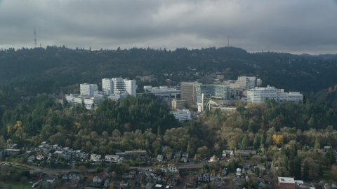 AX153_082.0000135F - Aerial stock photo of Oregon Health and Science University in the hills of Portland, Oregon