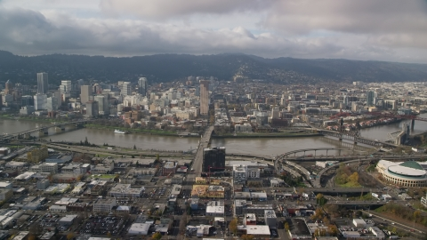 AX153_104.0000091F - Aerial stock photo of The Burnside Bridge and skyscrapers in Downtown Portland, Oregon