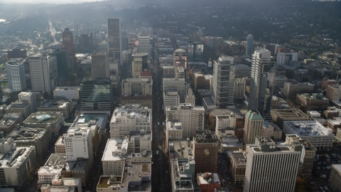 AX153_106.0000260F - Aerial stock photo of SW 6th Avenue and tall skyscrapers in Downtown Portland, Oregon