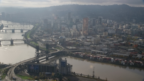 AX153_114.0000291F - Aerial stock photo of Bridges spanning the Willamette River and skyscrapers in Downtown Portland, Oregon