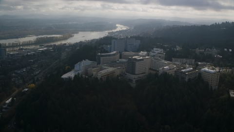 AX153_119.0000000F - Aerial stock photo of The hilltop Oregon Health and Science University in Portland, Oregon
