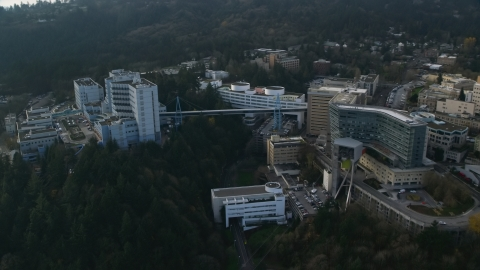 AX153_120.0000247F - Aerial stock photo of Oregon Health and Science University complex in Portland, Oregon