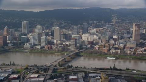AX153_121.0000284F - Aerial stock photo of Downtown Portland, Oregon across the Willamette River and Morrison Bridge
