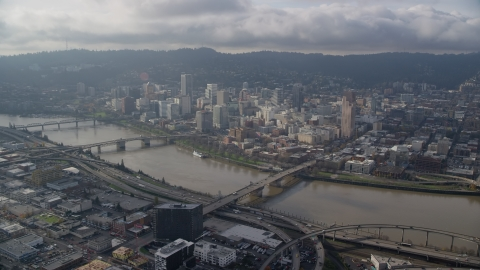 AX153_122.0000000F - Aerial stock photo of Bridges over the Willamette River and skyscrapers in Downtown Portland, Oregon