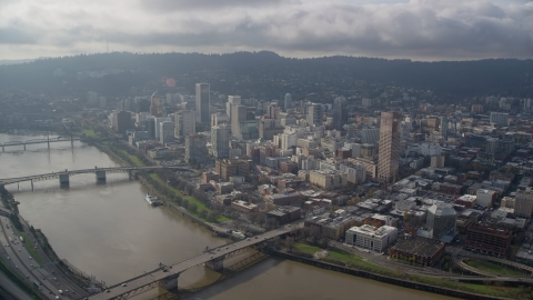 AX153_122.0000253F - Aerial stock photo of Three bridges spanning the Willamette River and skyscrapers in Downtown Portland, Oregon