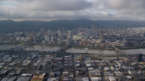 AX153_127.0000347F - Aerial stock photo of Hawthorne, Morrison, and Burnside Bridges, and skyscrapers in Downtown Portland, Oregon