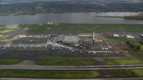 AX153_134.0000130F - Aerial stock photo of Approach Portland International Airport runways and terminals in Oregon