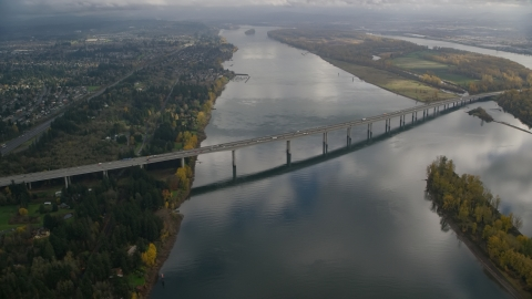 AX153_138.0000000F - Aerial stock photo of I-205 Bridge spanning Columbia River in Vancouver, Washington