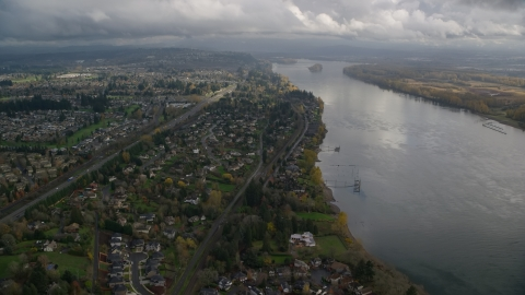 AX153_141.0000021F - Aerial stock photo of Suburban riverfront houses by Highway 14 in Vancouver, Washington