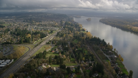 AX153_142.0000335F - Aerial stock photo of Highway 14 near suburban homes on the Columbia River in Vancouver, Washington