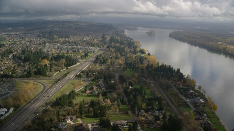 AX153_143.0000000F - Aerial stock photo of Suburban homes between Highway 14 and Columbia River, Vancouver, Washington