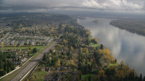 AX153_143.0000253F - Aerial stock photo of Suburban houses between Highway 14 and Columbia River, Vancouver, Washington