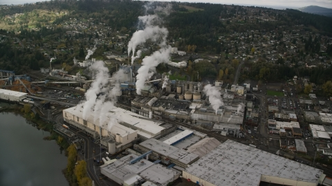 AX153_153.0000255F - Aerial stock photo of The Georgia Pacific Paper Mill with steam rising in Camas, Washington