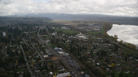 AX153_161.0000216F - Aerial stock photo of Small town neighborhoods in Washougal, Washington