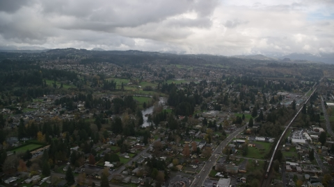 AX153_162.0000217F - Aerial stock photo of Neighborhoods in the small town of Washougal, Washington