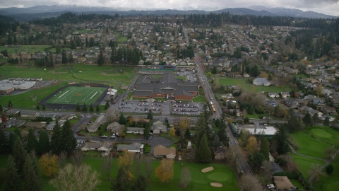 AX153_173.0000150F - Aerial stock photo of Washougal High School and sports fields in Washougal, Washington